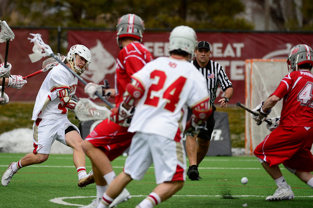 . Denver Connor Cannizzaro (40) takes a shot on goal during the first quarter at the University of Denver on February 27, 2016 in Denver, Colorado. Denver drafted Sacred Heart 18-7.  (Photo by Brent Lewis/The Denver Post)