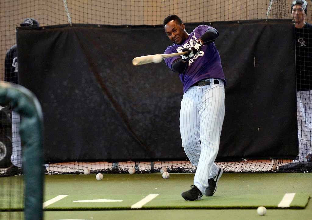 . SCOTTSDALE, AZ. - FEBRUARY 20: Chris Nelson (4) of the Colorado Rockies takes in some batting practice during workouts in the cages due to rain at Spring Training February 20, 2013 in Scottsdale. (Photo By John Leyba/The Denver Post)