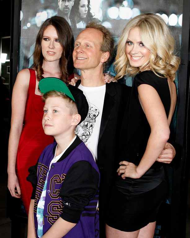 """. Danish director Niels Arden Oplev poses with his children (L-R) Linea, Thoreau and Anna at the premiere of his new film \""""Dead Man Down\"""" in Hollywood February 26, 2013. REUTERS/Fred Prouser"""