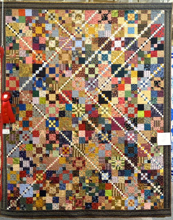 ". Jeff Forman/JForman@News-Herald.com ""Trail Mix\"" by Anne Schmidt, of Chardon, won second place in the medium bed quilt category."