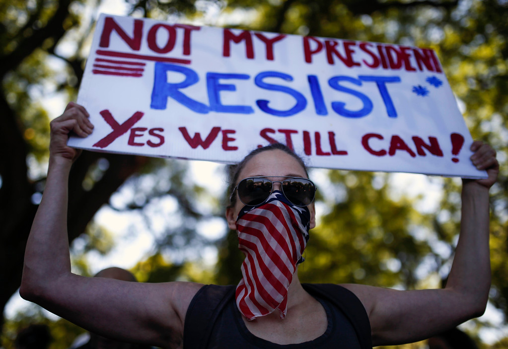 . A woman holds a sign during the women\'s march rally in Buenos Aires, Argentina, Saturday, Jan. 21, 2017. The march was held in solidarity with the Women\'s March on Washington, advocating women\'s rights and opposing Donald Trump\'s presidency. (AP Photo/Agustin Marcarian)
