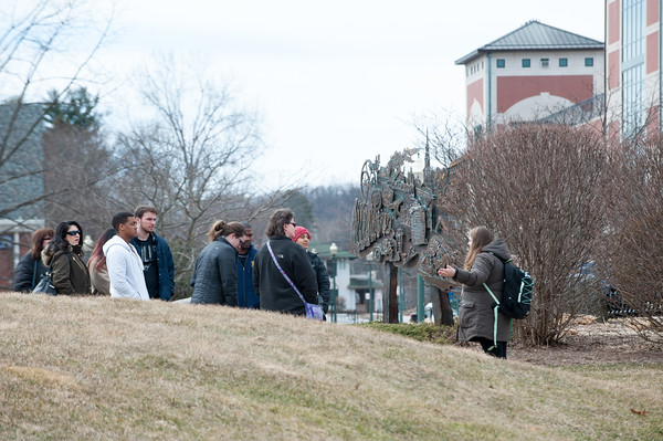 03/22/18 Wesley Bunnell | Staff A tour group makes its way towards the student center at CCSU on March 22nd.