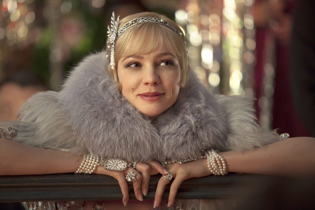 """. CAREY MULLIGAN as Daisy Buchanan in Warner Bros. Pictures� and Village Roadshow Pictures� drama, \""""THE GREAT GATSBY,\"""" a Warner Bros. Pictures release."""