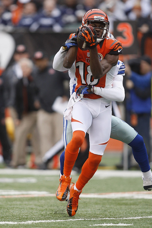 . A.J. Green #18 of the Cincinnati Bengals runs the ball upfield during the game against the Dallas Cowboys at Paul Brown Stadium on December 9, 2012 in Cincinnati, Ohio.  (Photo by John Grieshop/Getty Images)