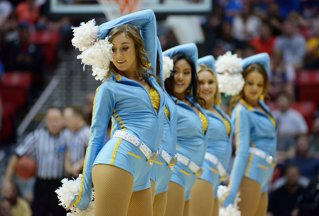 . UCLA Bruins cheerleaders perform in the second half against the Stephen F. Austin Lumberjacks during the third round of the 2014 NCAA Men\'s Basketball Tournament at Viejas Arena on March 23, 2014 in San Diego, California.  (Photo by Donald Miralle/Getty Images)