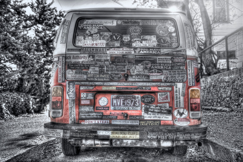 I was in Jerome AZ this week and I saw this cool van littered with stickers.  It was cool so I took a photo of it.  I like VW vans and I thought this one was totally unique.