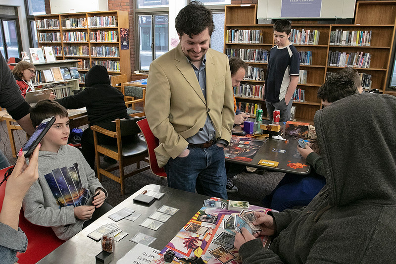 The Leominster and Fitcburg Public Library's held the championship round of their Magic The Gathering tournament on Saturday, Jan. 25, 2020 at the Fitchburg Public Library. The final match for the number one spot was between Chase Pratt-Bouchard, 11 in Gray, and Sebastian Cordio, 18, both from Leominster. Watching the match is Fitchburg Public Library's Teen Librarian Colin Welch. SENTINEL & ENTERPRISE/JOHN LOVE