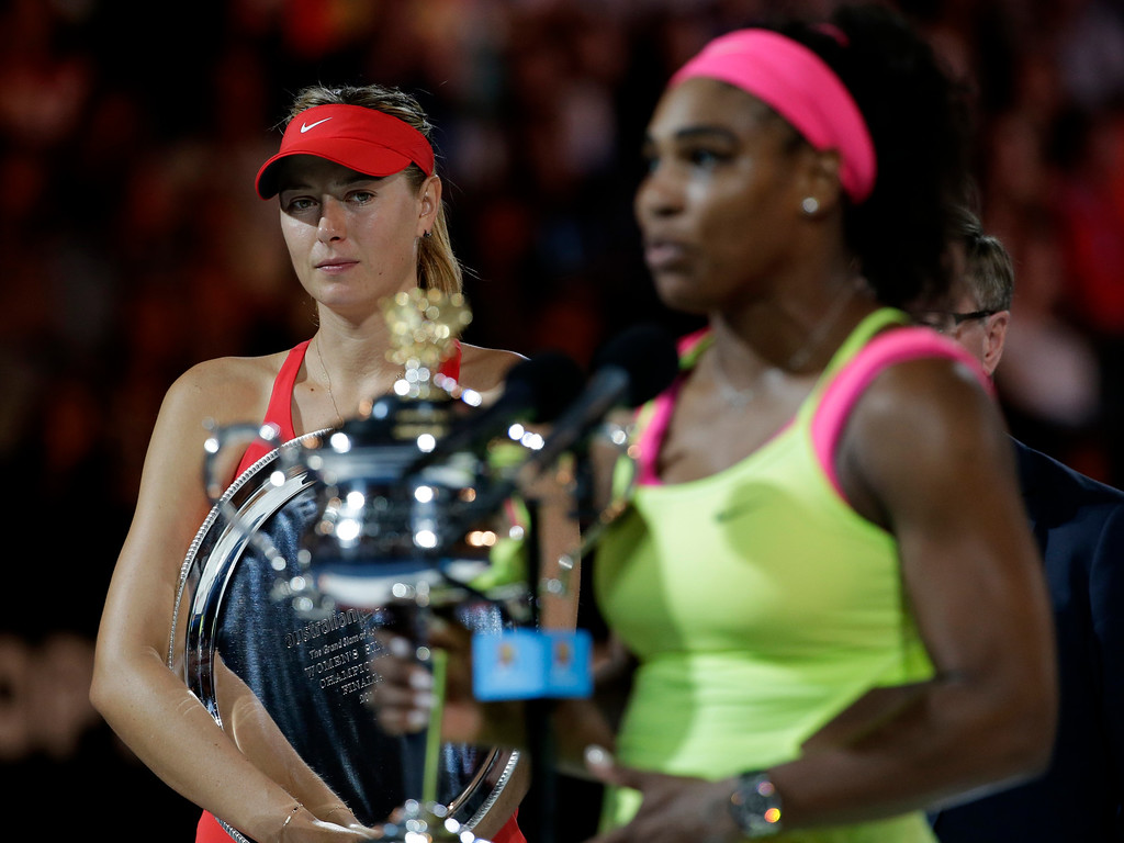 . Maria Sharapova of Russia, left,  looks at Serena Williams of the U.S. during the awarding ceremony after her women\'s singles final loss to Williams at the Australian Open tennis championship in Melbourne, Australia, Saturday, Jan. 31, 2015. (AP Photo/Vincent Thian)