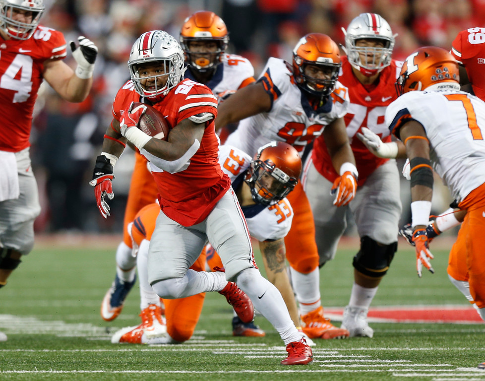 . Ohio State running back Mike Weber runs past the Illinois defense to score a touchdown during the first half of an NCAA college football game Saturday, Nov. 18, 2017, in Columbus, Ohio. (AP Photo/Jay LaPrete)