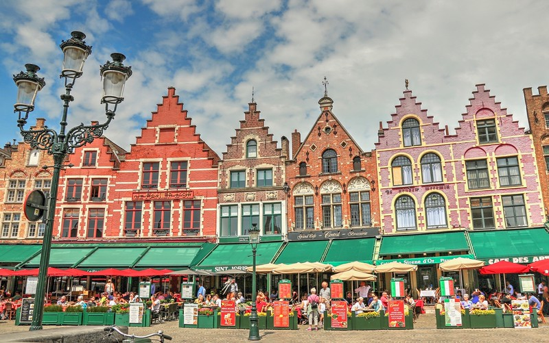 Candy colored guild houses of Markt Square - Bruges, Belgium