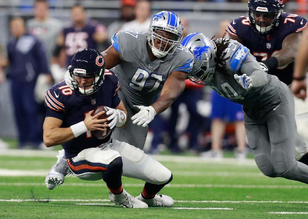 . Detroit Lions defensive tackle Akeem Spence (97) sacks Chicago Bears quarterback Mitchell Trubisky (10) during the second half of an NFL football game, Saturday, Dec. 16, 2017, in Detroit. (AP Photo/Rey Del Rio)