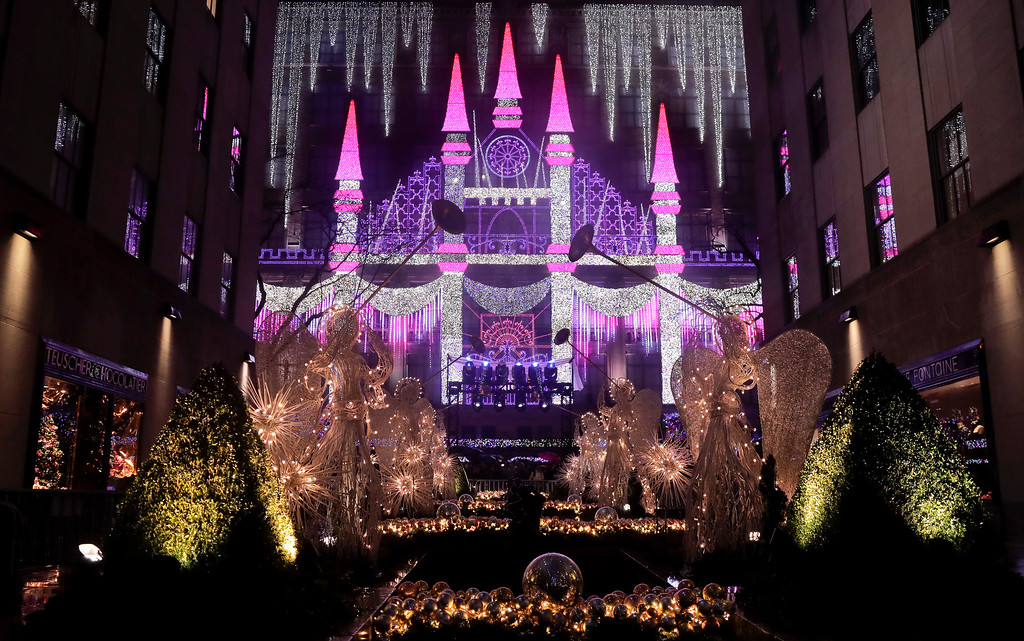 . Christmas angels frame the side of the Saks Fifth Avenue store which was aglow with lights across from Rockefeller Center during the 84th annual Rockefeller Center Christmas tree lighting ceremony, Wednesday, Nov. 30, 2016, in New York. The 94-foot tall Norway spruce is covered with 50,000 multicolored LED lights. (AP Photo/Julie Jacobson)