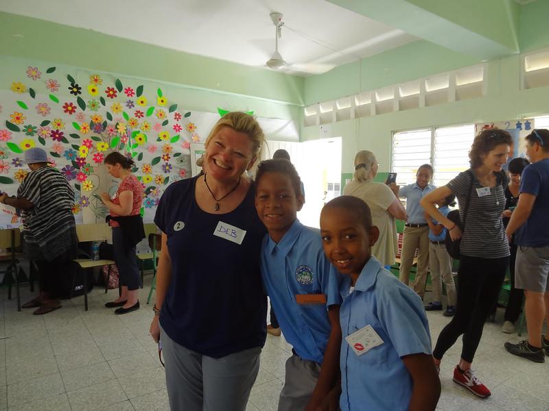 Deb with Students Fathom Cruises.jpg