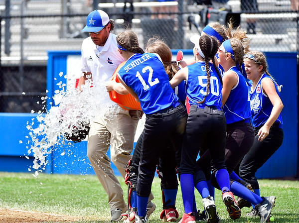 7/25/2019 Mike Orazzi | Staff Members of the South Little League from South Williamsport, Pa, celebrate a 3-2 win over Milford Little League from Milford, Conn. during the Eastern Regional Softball Tournament at Breen Field in Bristol on Thursday.