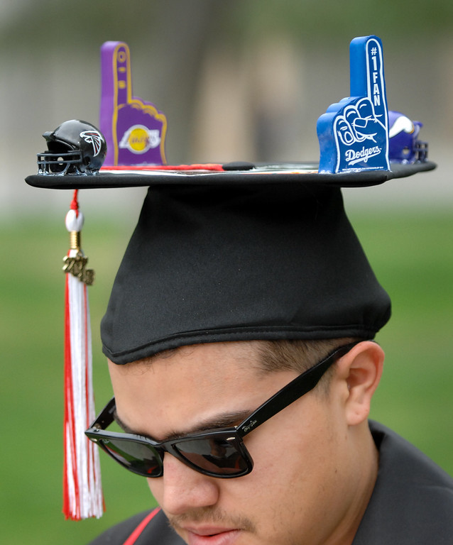 . Matthew Rubinfeld adorned his mortarboard with sports stuff for the commencement ceremonies at CSUN, Tuesday, May 21, 2013. (Michael Owen Baker/L.A. Daily News)