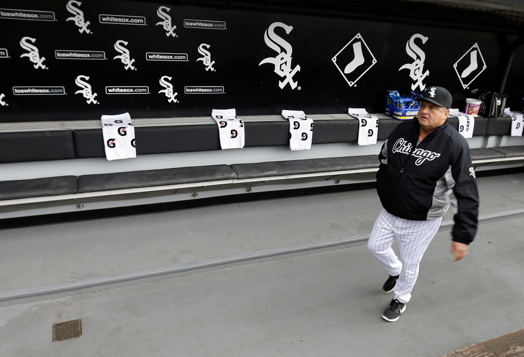 . Chicago White Sox pitching coach Don Cooper walks in the dugout before an opening day baseball home game against the Cleveland Indians Friday, April 8, 2016, in Chicago. (AP Photo/Nam Y. Huh)