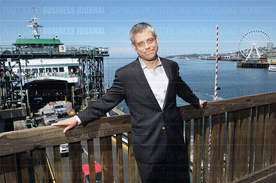 Emory Thomas returns to Seattle as publisher of the Puget Sound Business Journal, as seen here on the waterfront in Seattle, Washington