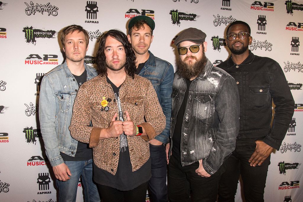 . Dave Tirio, from left, Tom Higgenson, Tim Lopez, Mike Retondo and De\'Mar Hamilton of the Plain White T\'s seen at 2017 Alternative Press Music Awards at the KeyBank State Theatre on Monday, July 17, 2017, in Cleveland. (Photo by Amy Harris/Invision/AP)