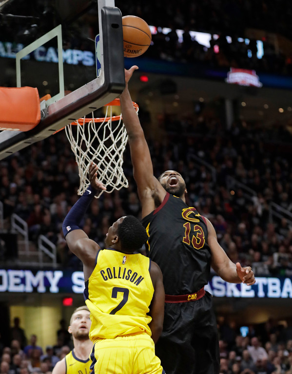 . Cleveland Cavaliers\' Tristan Thompson (13) blocks a shot by Indiana Pacers\' Darren Collison (2) in the second half of Game 7 of an NBA basketball first-round playoff series, Sunday, April 29, 2018, in Cleveland. (AP Photo/Tony Dejak)