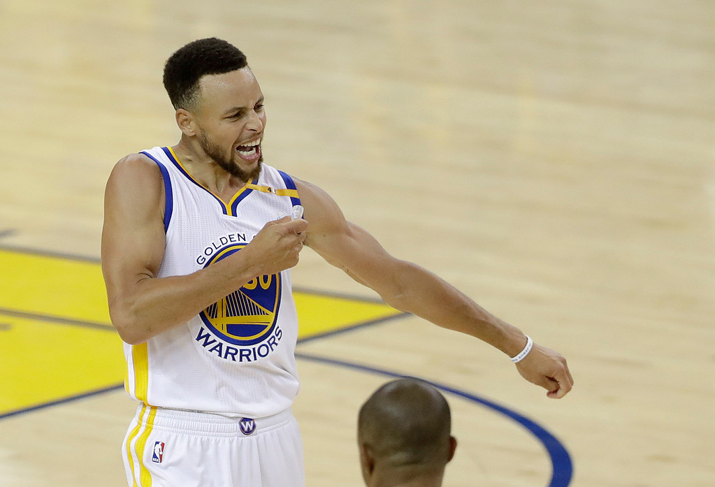. Golden State Warriors guard Stephen Curry (30) reacts after scoring against the Cleveland Cavaliers during the second half of Game 2 of basketball\'s NBA Finals in Oakland, Calif., Sunday, June 4, 2017. (AP Photo/Marcio Jose Sanchez)