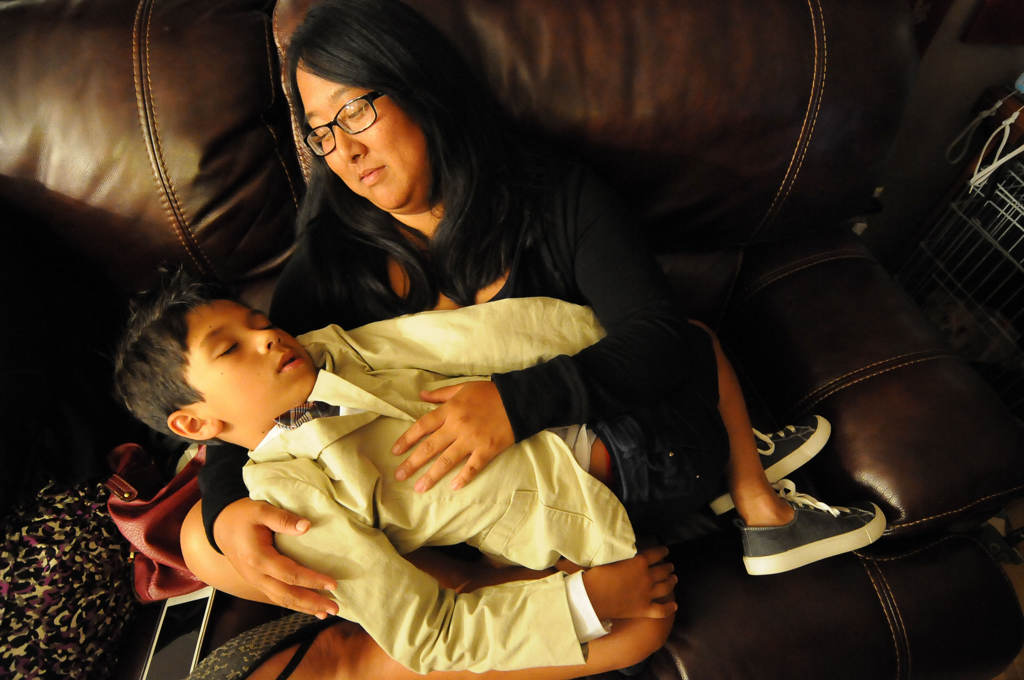 . Ryan Pfeifle and Bradley Weber\'s youngest son, Josh Pfeifle-Weber, 11, fell asleep in the arms of family friend Jenna Meade about an hour before the midnight wedding. (Pioneer Press: Sherri LaRose-Chiglo)