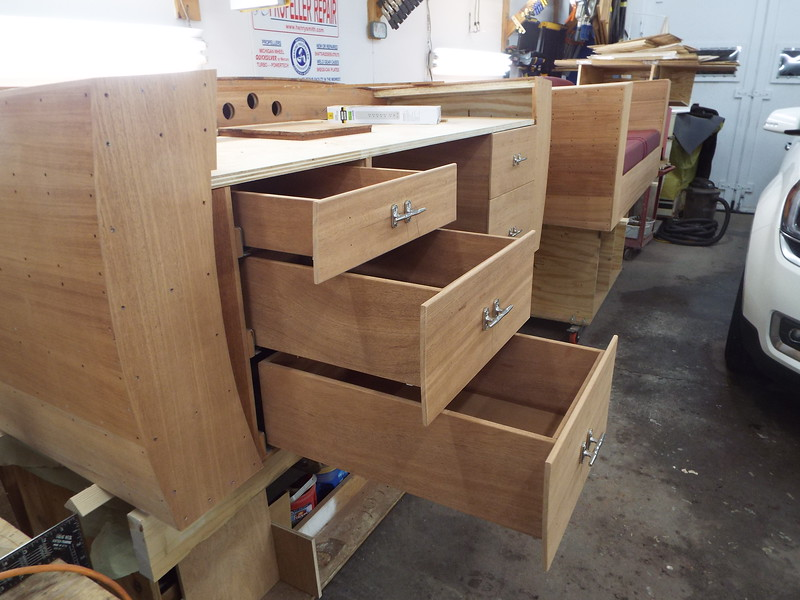 Drawers with fronts in place and pulls mounted.