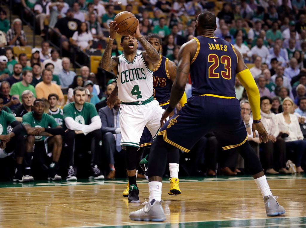 . Boston Celtics guard Isaiah Thomas (4) prepares to shoot as Cleveland Cavaliers forward LeBron James (23) defends during the first quarter of Game 1 of the NBA basketball Eastern Conference finals, Wednesday, May 17, 2017, in Boston. (AP Photo/Charles Krupa)