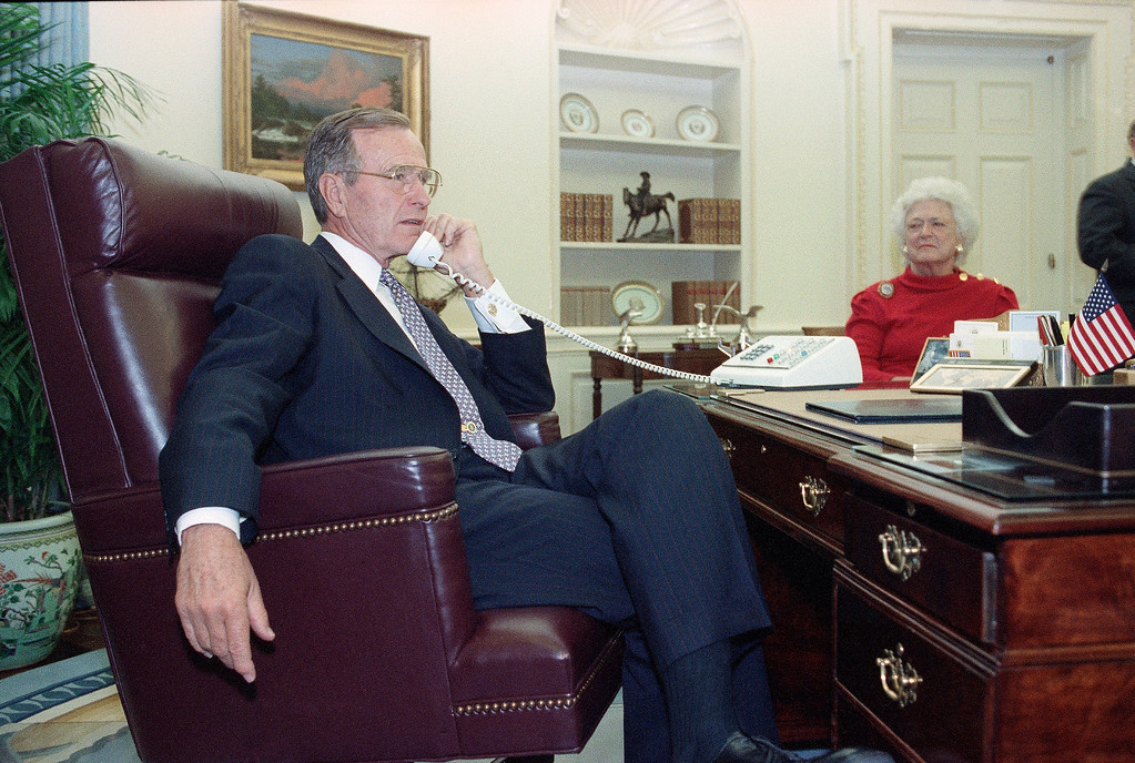 . U.S. President George Bush congratulates Supreme Court nominee Clarence Thomas by phone from the Oval Office in Washington, Oct. 15, 1991, as Mrs. Bush looks on. The nomination of Thomas was approved by the Senate by a vote of 52-48. (AP Photo/Barry Thumma)