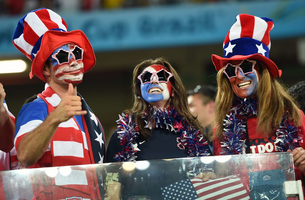. US fans cheer before a Group G football match between Ghana and US at the Dunas Arena in Natal during the 2014 FIFA World Cup on June 16, 2014. AFP PHOTO / EMMANUEL DUNAND/AFP/Getty Images