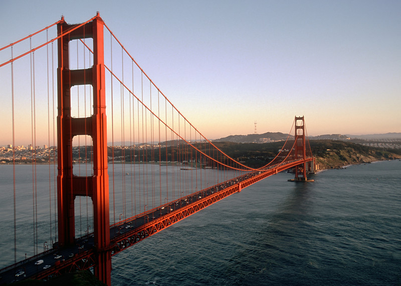 The last rays of sunset illuminate the Golden Gate Bridge in San Francisco.