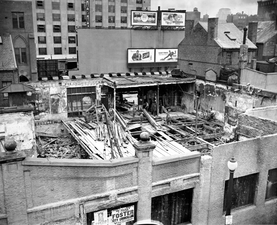 . Workmen remove debris preparatory to the erection of a garage on the site of the 1942 Cocoanut Grove Night Club fire in Boston, Mass., on Nov. 28, 1945.  (AP Photo)