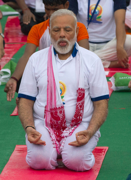 . Indian Prime Minister Narendra Modi performs yoga to mark international yoga day in Lucknow, India, Wednesday, June 21, 2017. Millions of yoga enthusiasts across India take part in a mass yoga sessions to mark the third International Yoga Day which falls on June 21 every year. (AP Photo/Rajesh Kumar Singh)