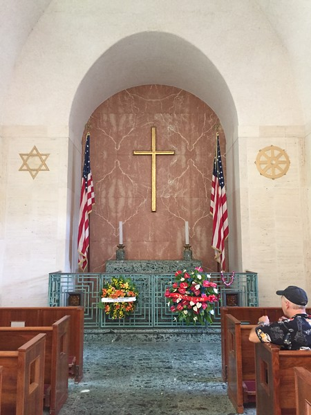 The chapel altar, stairs, and floor are Verde Antico marble.  The Latin Cross is displayed on  Rojo Alicante marble.
