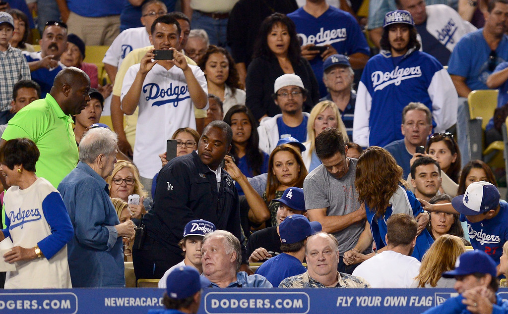 . A woman is taken from her seat after being hit by Dodgers\' Hanley Ramirez\' broken bat as they play the Rockies at Dodger Stadium Saturday, September 28, 2013. (Photo by Sarah Reingewirtz/Pasadena Star-News)
