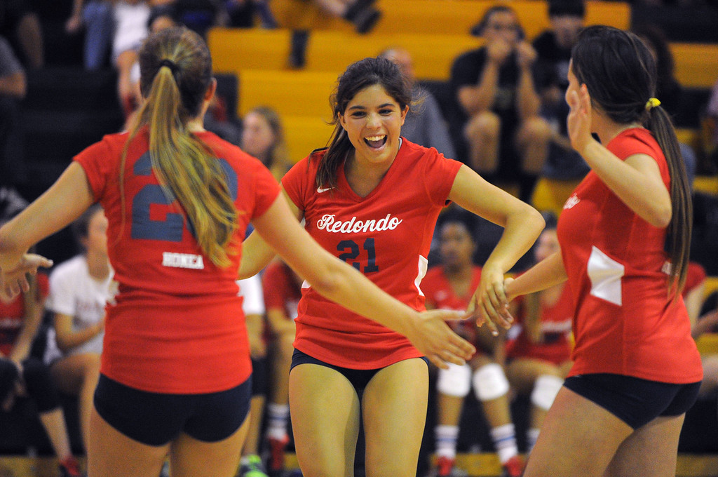 . Redondo girls volleyball takes on Bishop Montgomery in a non league match in Torrance on 09/10/2013. Redondo won 3-0. Redondo\'s Brittany Ungermann, center, celebrates a point with teammates. (Photo by Scott Varley, Daily Breeze)
