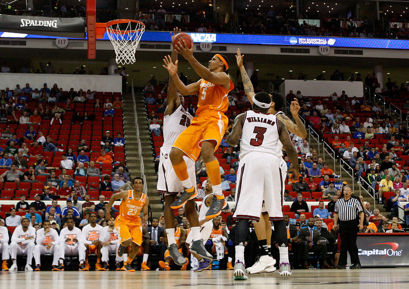 . Jarnell Stokes #5 of the Tennessee Volunteers goes up for a shot against Cady Lalanne #25 of the Massachusetts Minutemen in the second round of the 2014 NCAA Men\'s Basketball Tournament at PNC Arena on March 21, 2014 in Raleigh, North Carolina.  (Photo by Streeter Lecka/Getty Images)