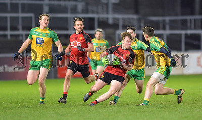 Down substitute Darragh O'Hanlon attacks the Donegal defence. RS1605108