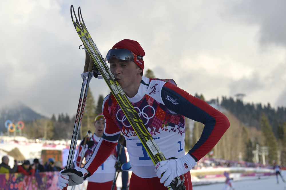 . Norway\'s Ola Vigen Hattestad kisses his skis after winning gold in the Men\'s Cross-Country Skiing Individual Sprint Free Final at the Laura Cross-Country Ski and Biathlon Center during the Sochi Winter Olympics on February 11, 2014 in Rosa Khutor near Sochi . (ODD ANDERSEN/AFP/Getty Images)