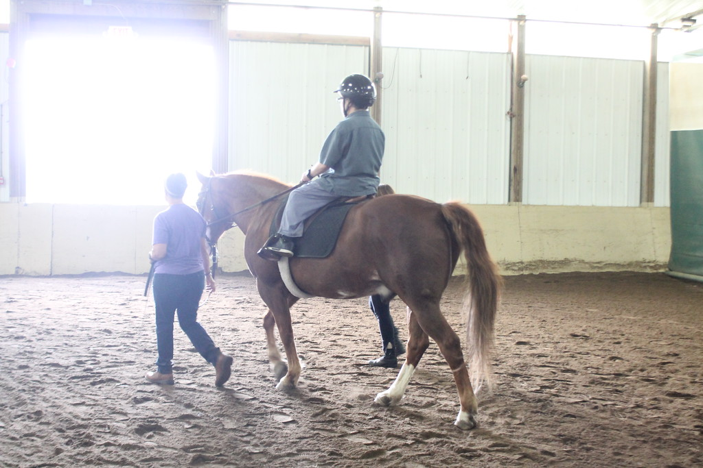. Dan Matthews,   a client  Willoughby Branch with the help of Fieldstone Farm volunteers rides a horse as part of the equine therapy sessions clients of  Lake County\'s Board of Developmental Disabilities/Deepwood regularly participate in . Kristi Garabrandt - The News-Herald