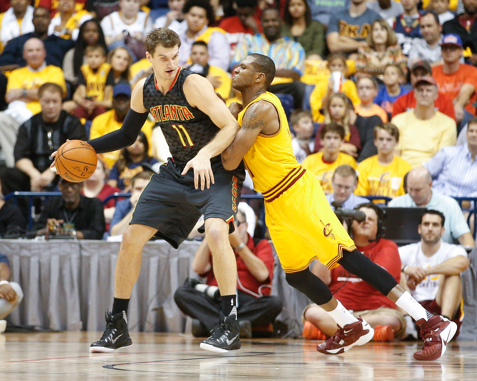 . Atlanta Hawks forward Tiago Splitter (11) is defended by Cleveland Cavaliers guard James Jones, right, in the first half of an NBA preseason basketball game, Wednesday, Oct. 7, 2015, in Cincinnati. The Hawks won 98-96. (AP Photo/John Minchillo)
