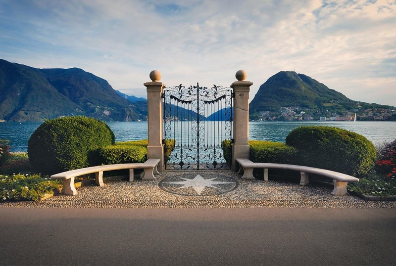 The famous gate of Parco Ciani. Source: https://www.luganoregion.com/en