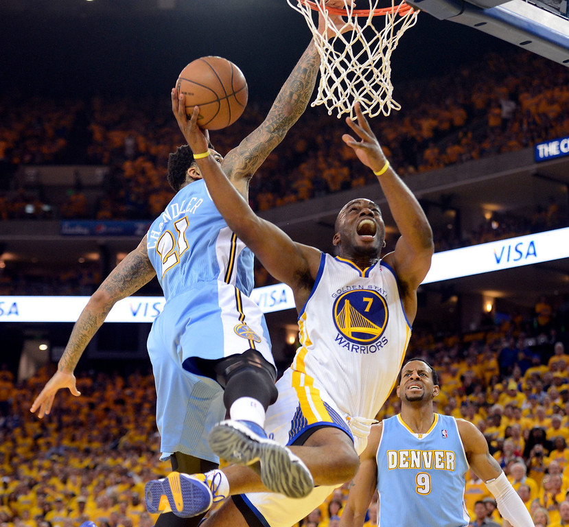 . Carl Landry (7) of the Golden State Warriors drives to the basket and gets fouled by Wilson Chandler (21) of the Denver Nuggets during the third quarter in Game 6 of the first round NBA Playoffs May 2, 2013 at Oracle Arena. (Photo By John Leyba/The Denver Post)