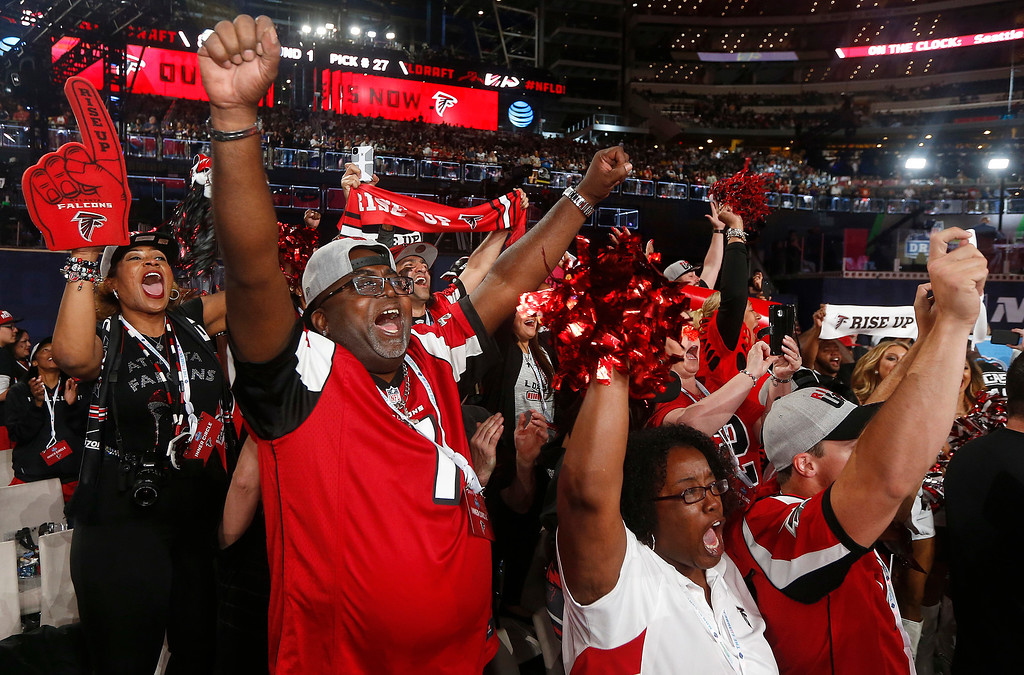 . Atlanta Falcons fans cheer during the first round of the NFL football draft, Thursday, April 26, 2018, in Arlington, Texas. (AP Photo/Michael Ainsworth)