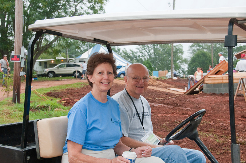 Linda Fuller hops aboard Bill Scott's golf cart for a personal tour of 8 Greater Blessing homes in the neighborhood. mlj