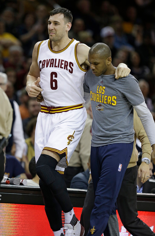 . Cleveland Cavaliers\' Andrew Bogut (6) is helped off the court by James Jones in the first half of an NBA basketball game against the Miami Heat, Monday, March 6, 2017, in Cleveland. (AP Photo/Tony Dejak)