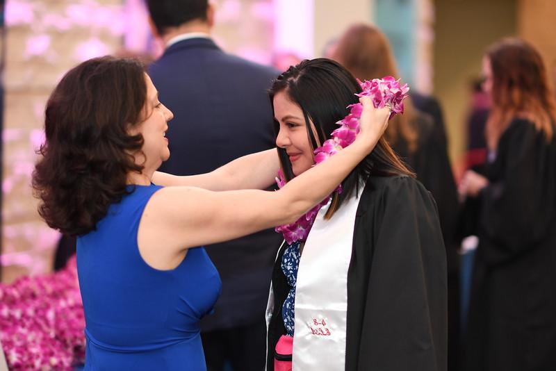 Islanders pick up their spring 2019 graduation lei from members of the National Islander Alumni Association.