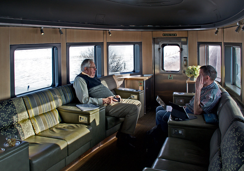 The interior of a Park car after it has been refurbished for Prestige service.  It is a fine place for meeting people in the lounge,  sightseeing from the dome, and getting snacks and adult drinks at the bar.  Not to mention morning coffee.