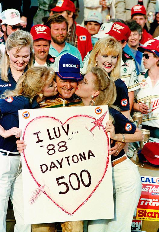 . Bobby Allison, from Hueytown, Ala., gets victory\'s reward after winning the Daytona 500 auto race in Daytona Beach, Fla., Feb. 15, 1988. (AP Photo/Walt Chernokal)