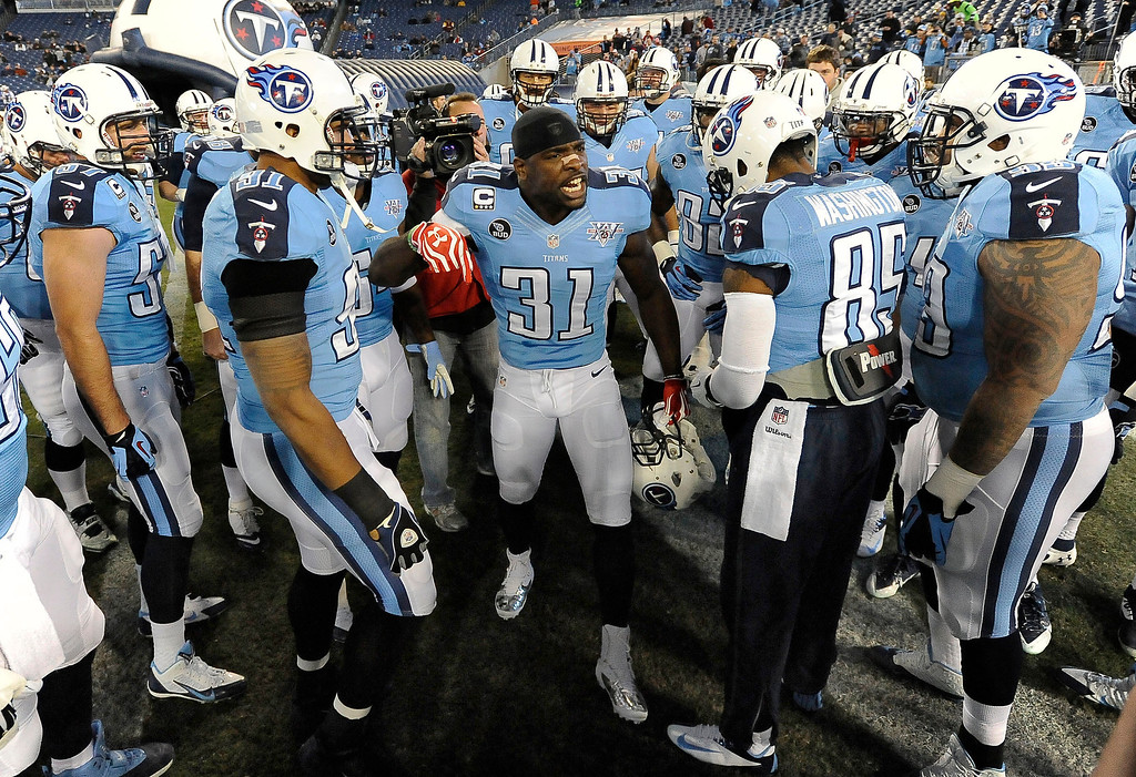 . Tennessee Titans safety Bernard Pollard (31) encourages his teammates before an NFL football game against the Indianapolis Colts on Thursday, Nov. 14, 2013, in Nashville, Tenn. (AP Photo/Mark Zaleski)