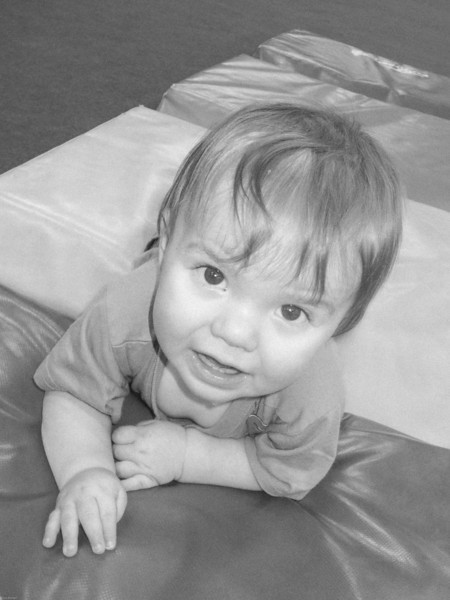 Child on gymnastics mats
